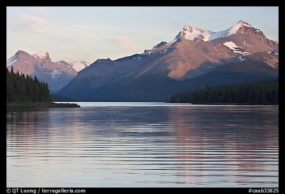 Peaks reflected in rippled water, Maligne Lake, sunset. Jasper National Park, Canadian Rockies, Alberta, Canada (color)