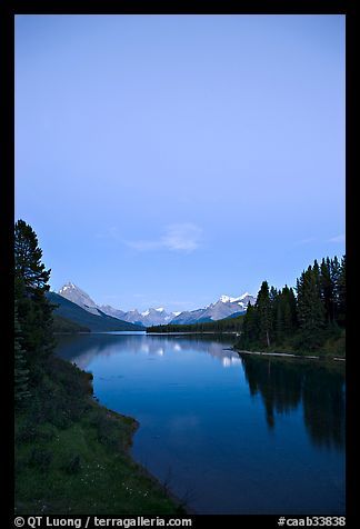 Maligne Lake from the outlet of the Maligne River, blue dusk. Jasper National Park, Canadian Rockies, Alberta, Canada (color)