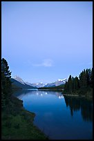 Maligne Lake from the outlet of the Maligne River, blue dusk. Jasper National Park, Canadian Rockies, Alberta, Canada ( color)