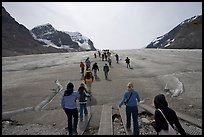 Tourists walking onto  Athabasca Glacier. Jasper National Park, Canadian Rockies, Alberta, Canada (color)