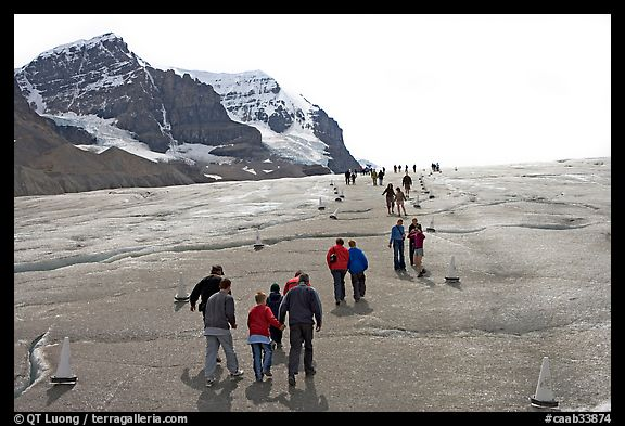 Tourists and families on Athabasca Glacier. Jasper National Park, Canadian Rockies, Alberta, Canada (color)