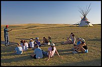 First nations man giving a lecture to students, Head-Smashed-In Buffalo Jump. Alberta, Canada