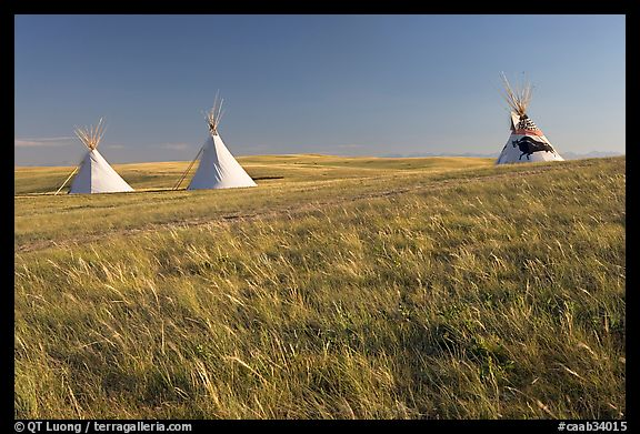 Teepees and tall grass prairie, Head-Smashed-In Buffalo Jump. Alberta, Canada (color)