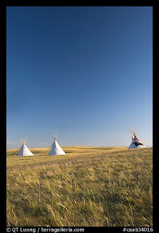 Teepee tents and prairie, late afternoon, Head-Smashed-In Buffalo Jump. Alberta, Canada (color)