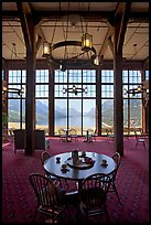 Table in lobby of Prince of Wales hotel with view over Waterton Lake. Waterton Lakes National Park, Alberta, Canada (color)