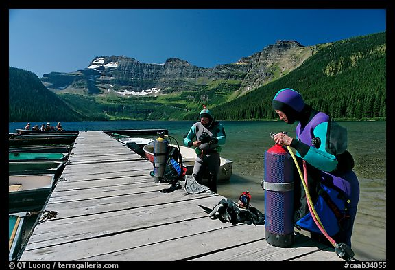 Scuba divers getting ready to dive, Cameron Lake. Waterton Lakes National Park, Alberta, Canada (color)