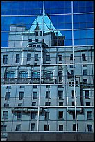 Buildings reflected in the glass windows of a high-rise buildings. Vancouver, British Columbia, Canada ( color)