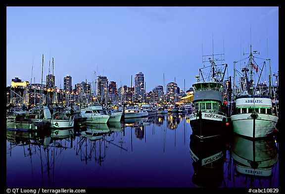 Fishing boats and skyline at dusk. Vancouver, British Columbia, Canada (color)