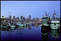 Fishing boats and skyline at dusk. Vancouver, British Columbia, Canada