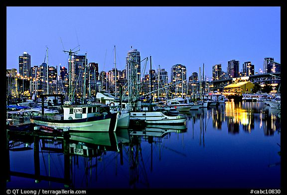 Fishing boats and skyline at night. Vancouver, British Columbia, Canada (color)