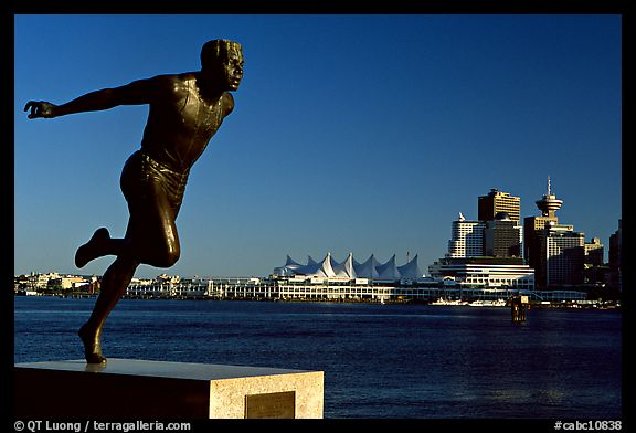 Runner's statue and Harbor center, late afernoon. Vancouver, British Columbia, Canada (color)