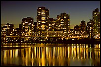 High-rise buildings reflected in False Creek at night. Vancouver, British Columbia, Canada ( color)