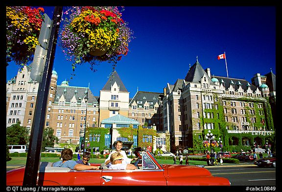 Red convertible car and Empress hotel. Victoria, British Columbia, Canada (color)