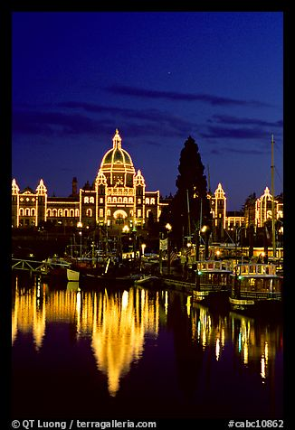 Parliament buildings lights reflected in the harbor. Victoria, British Columbia, Canada (color)