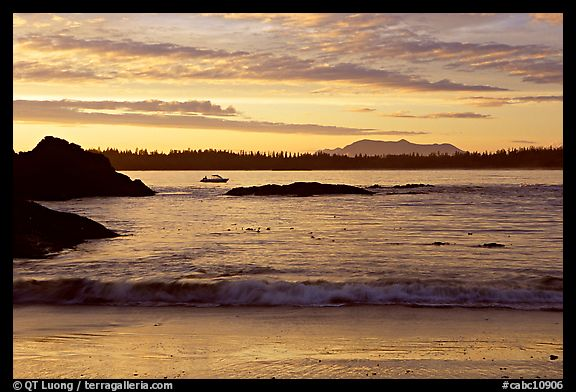 Marine landscape with a small boat in a distance, sunset. Pacific Rim National Park, Vancouver Island, British Columbia, Canada (color)