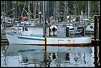 Fishing boat and reflections in harbor, Uclulet. Vancouver Island, British Columbia, Canada ( color)