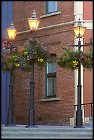 Street lamps with flower baskets and brick wall. Victoria, British Columbia, Canada ( color)