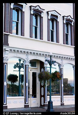 Store with reflections in windows. Victoria, British Columbia, Canada (color)