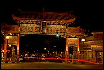 Gate of Harmonious Interest marking the entrance of Chinatown, night. Victoria, British Columbia, Canada