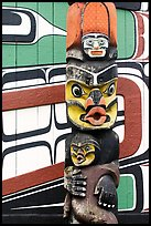Totem pole and wall of Carving studio. Victoria, British Columbia, Canada (color)
