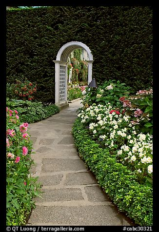 Arched entrance  leading to the Italian Garden. Butchart Gardens, Victoria, British Columbia, Canada (color)