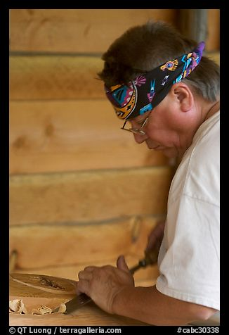 Artist carving a totem pole. Butchart Gardens, Victoria, British Columbia, Canada (color)