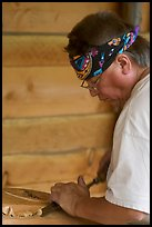 Artist carving a totem pole. Butchart Gardens, Victoria, British Columbia, Canada