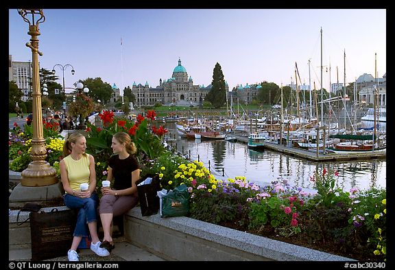 Young Women sitting, Inner harbor. Victoria, British Columbia, Canada (color)