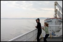 Woman and girl looking out from deck of ferry. Vancouver Island, British Columbia, Canada ( color)