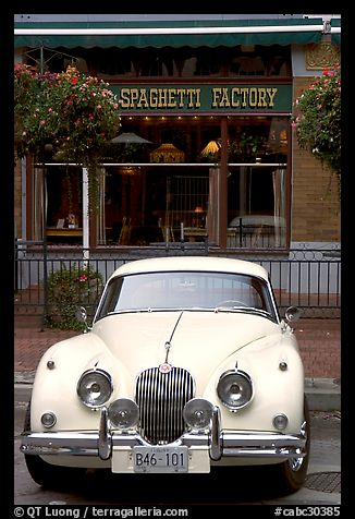 Classic car in front of Spaghetti Factory restaurant. Vancouver, British Columbia, Canada (color)