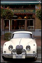 Classic car in front of Spaghetti Factory restaurant. Vancouver, British Columbia, Canada
