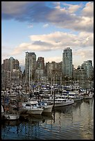 Skyline and boats seen from Fishermans harbor, late afternoon. Vancouver, British Columbia, Canada (color)