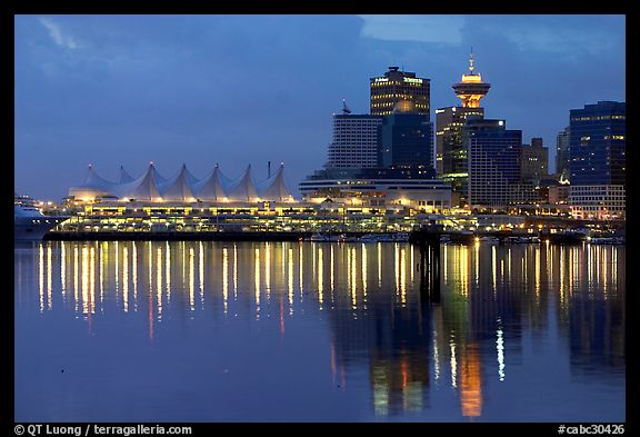 Canada Palace at night and Harbor Center at night. Vancouver, British Columbia, Canada (color)