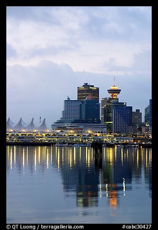 Canada Palace at night and Harbor Center at dawn. Vancouver, British Columbia, Canada (color)