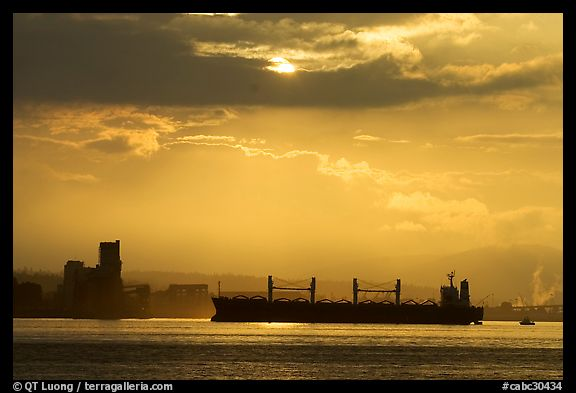 Cargo ship in harbor a sunrise. Vancouver, British Columbia, Canada (color)
