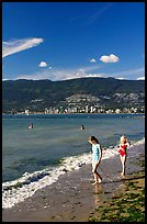 Girls on a beach, Stanley Park. Vancouver, British Columbia, Canada (color)