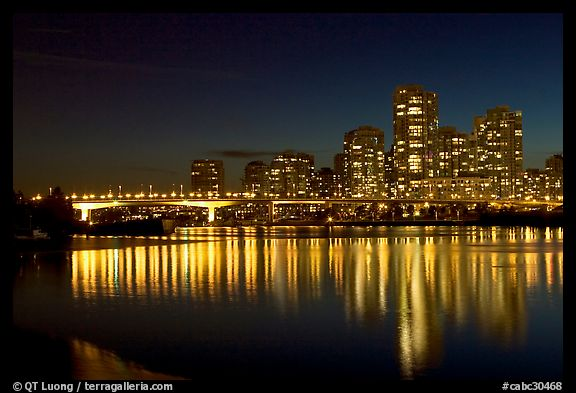 Skyline seen across False Creek at night. Vancouver, British Columbia, Canada (color)