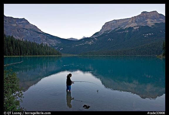 Woman fishing in Emerald Lake, sunset. Yoho National Park, Canadian Rockies, British Columbia, Canada (color)