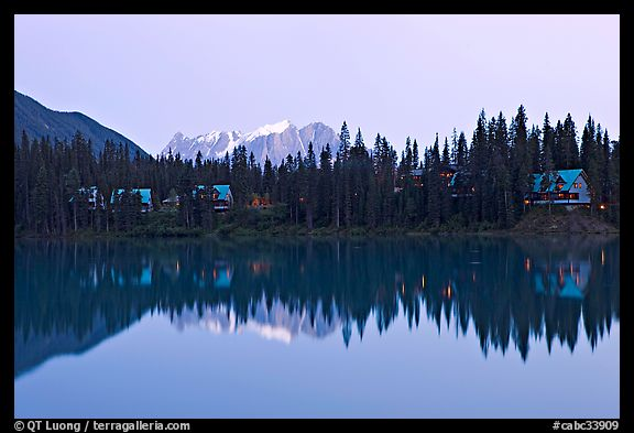 Trees and cabins reflected in Emerald Lake, dusk. Yoho National Park, Canadian Rockies, British Columbia, Canada (color)