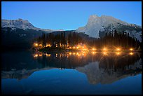 Lighted cabins and mountains reflected in Emerald Lake at night. Yoho National Park, Canadian Rockies, British Columbia, Canada