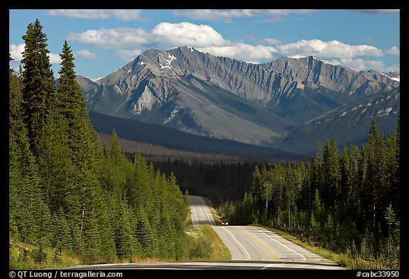 Kootenay Parkway highway and mountains, afternoon. Kootenay National Park, Canadian Rockies, British Columbia, Canada (color)