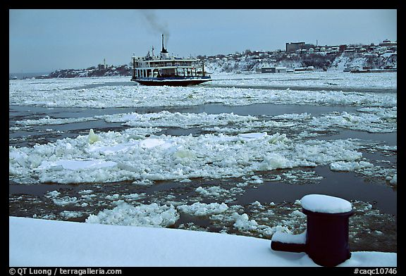 Ferry crossing the Saint Laurent river partly covered with ice, Quebec City. Quebec, Canada (color)