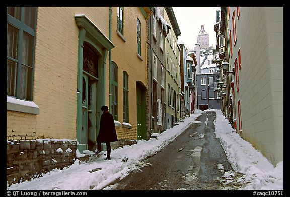 Narrow street partly covered with snow, Quebec City. Quebec, Canada (color)