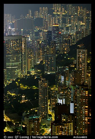 Residential towers on steep hillside from Victoria Peak by night. Hong-Kong, China (color)
