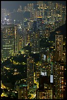 Residential towers on steep hillside from Victoria Peak by night. Hong-Kong, China ( color)