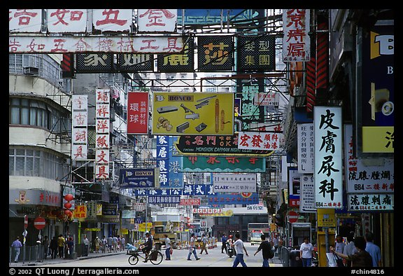Street in Kowloon with signs in Chinese. Hong-Kong, China (color)