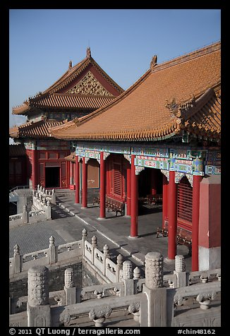 Pavilion with red columns and yellow roof tiles typical of imperial architecture, Forbidden City. Beijing, China (color)