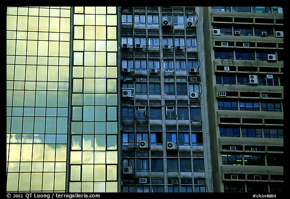 Glass building next to older buildings with air conditioners, Hong-Kong Island. Hong-Kong, China (color)