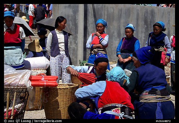 Women of the Bai tribe selling incense. Shaping, Yunnan, China (color)
