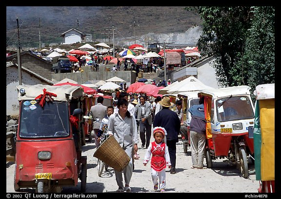 Tuk-tuk waiting for villagers ouside the Monday market. Shaping, Yunnan, China (color)